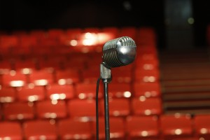 An old-fashioned microphone standing on a stage.