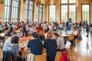 Groups of students participate in conversations at Peirce Dining Hall.