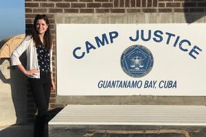 "Julia McKay with a ""Camp Justice"" sign at Guantanamo Bay."