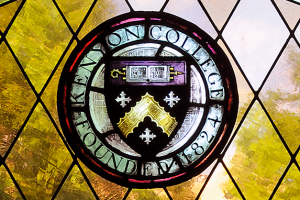 The Kenyon College seal rendered in stained glass.