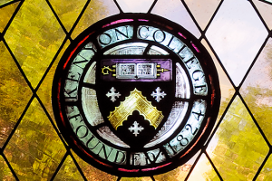 The Kenyon seal rendered in stained glass.