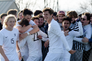 Members of the Kenyon men's Lords soccer team rejoice after a victory.