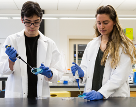 Jeremy Moore and Sarah Manz in the lab.