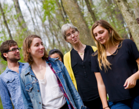 Professor Siobhan Fennessy and students in the forest.