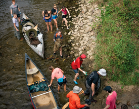 Students and canoes on the river