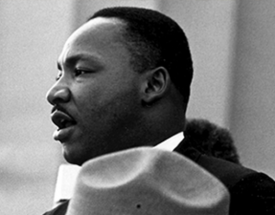 Dr Martin Luther King speaking in a black and white photo