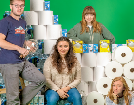 Students pose with an array of products.
