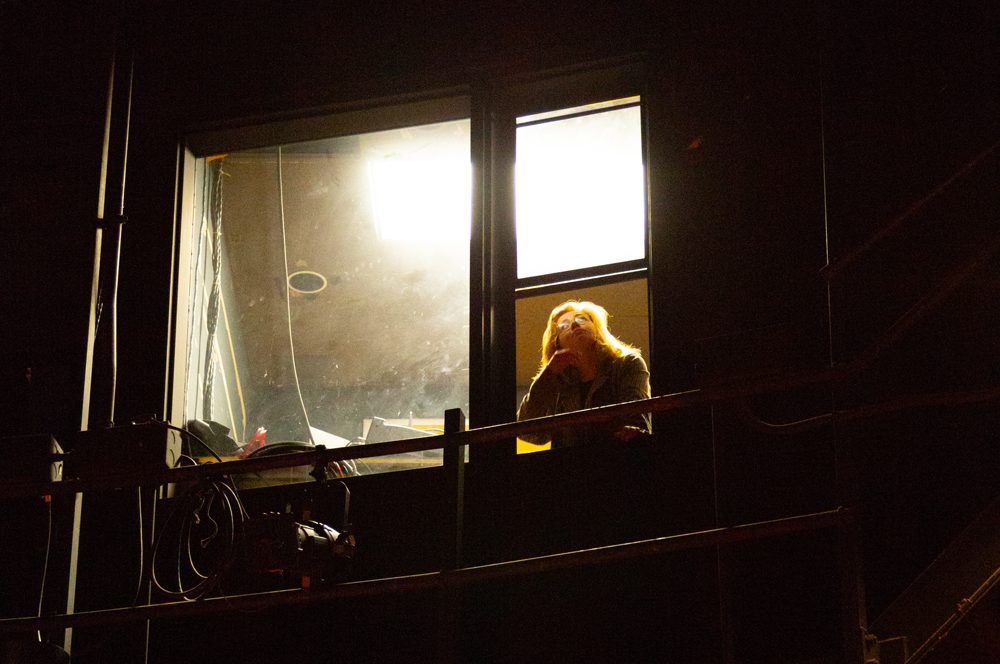 Stage manager at window