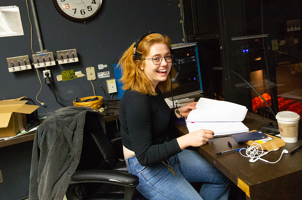 Stage manager at her desk